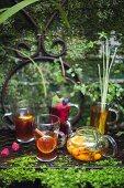 Various summer drinks on a garden table