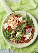 Pasta salad with tuna, mozzarella, tomato and basil
