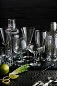 Various cocktail glasses and bar utensils