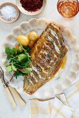 Fish with chilli butter and potatoes (seen from above)