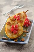 Pears with redcurrant sauce and flaked almonds