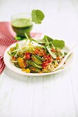 Indian vegetable salad with shoots, apricots and pepper dressing