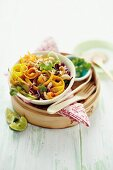 Raw salad with coconut and tamarind dressing