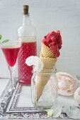 An ice cream cone with raspberry ice cream and home-made raspberry liqueur