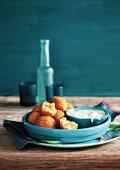 Swordfish and parsnip balls in breadcrumbs with a yoghurt dip