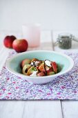 A fresh salad with peach, burrata and balsamic vinegar