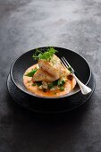 John Dory with lobster bisque on a bed of risotto with peas and cauliflower