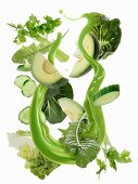 A splash of green smoothie with ingredients