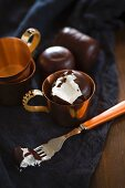 A chocolate marshmallow in a copper cup