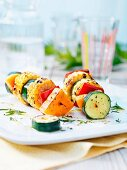 Grilled vegetable skewers with courgettes, corn, peppers and pumpkin