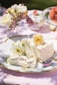 Ice cream dessert decorated with flowers on a garden table