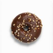 A Nutella doughnut with chocolate glaze and chopped hazelnuts
