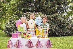Children at birthday party in summery garden