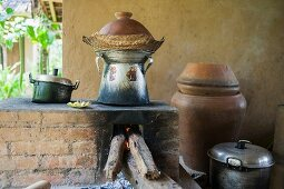 Pots over a wood-fired oven in an outdoor kitchen