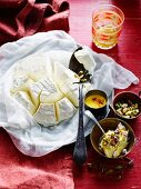 Shrikhand (Indian yoghurt dessert) with pistachios and saffron sauce