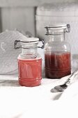 Rhubarb juice and rhubarb compote in glass containers