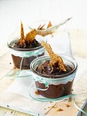 Chocolate cake with sesame brittle in glasses as a gift