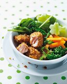 Crispy breaded salmon with steamed broccoli and carrot sticks