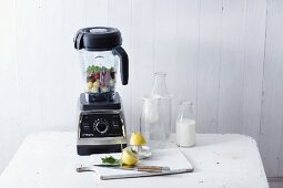 A blender and kitchen utensils for making smoothies