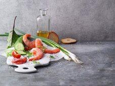 An arrangement of prawns and salad ingredients