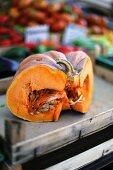 A slice of Muscade de Provence pumpkin at a market