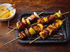 Exotic pork skewers with dried apricots and bacon