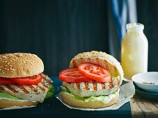Grilled tuna fish burgers with tomatoes and salad