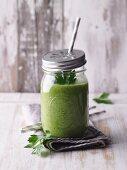 A green avocado smoothie with batavia and wheatgrass powder