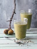 Fig and avocado smoothies with plums, sunflower seeds and spirulina