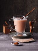 An apple and coconut milk smoothie with cinnamon and lemon