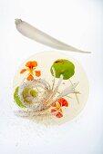 Daikon radish and sesame salad with lime dressing and white chocolate