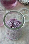 A jar of violet sweets