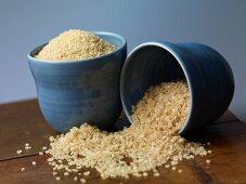 Bulgur and couscous in blue bowls