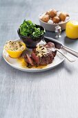 Beefsteak with pepper butter and baked, salted potatoes