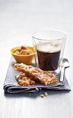 Salted peanut brittle with a glass of coffee