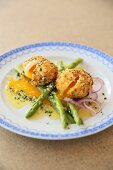 Green asparagus with fried eggs in a Parmesan coating