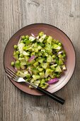 Green vegetable salad with peas, cucumber, apples and celery