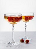 Champagne cocktails with gold-dusted raspberries