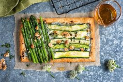 A puff pastry tart with courgettes, asparagus and blue cheese