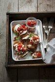 Loaded hasselback potatoes with buche, tomato salsa and chorizo crumbs