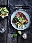 T-Bone Steak with pickled chili, corn & avocado