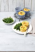 Mini frittatas with smoked salmon and broccoli served with green beans