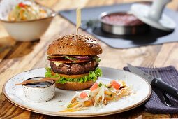 US-style beef burgers with honey-barbecue sauce and coleslaw