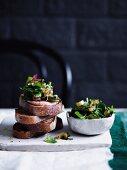 Charred rainbow chard with garlic crostini and hummus, bread