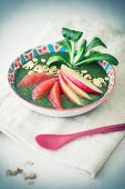 A smoothie bowl with lamb's lettuce, grapefruit and apple