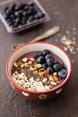 A smoothie bowl with blueberries and almonds