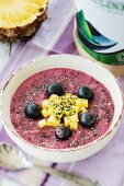 A smoothie bowl with grapes and pineapple