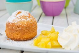 Coconut cake with fresh pineapple and whipped cream
