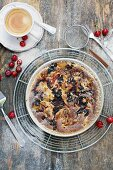 Gluten-free rhubarb and cherry pie with a cup of coffee