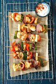 Chicken and vegetable skewers with a spicy yoghurt dip